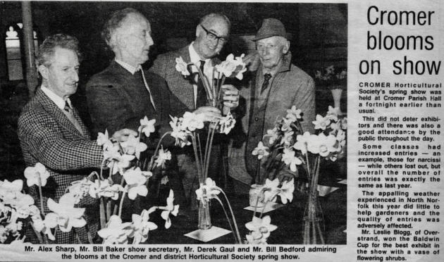 A newspaper cutting of coverage of Cromer Horticultural Society's spring show at Cromer Parish Hall. Pictured are, from left, Alex Sharp, North Lodge Park superintendant and caretaker Bill Baker, Derek Gaul and Bill Bedford.